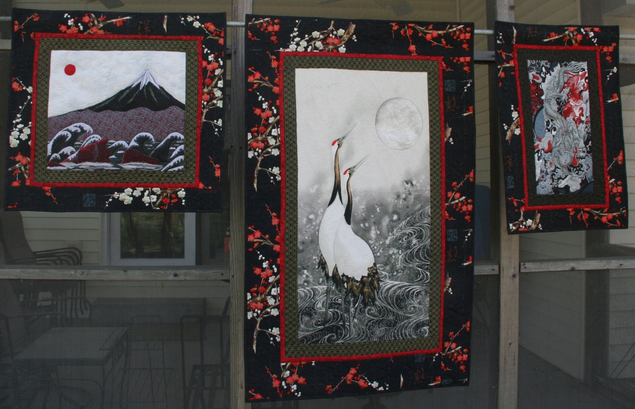 The quilts are, from left, Mt. Fuji with Waves and Red Moon; Cranes and Moon, Adams Dragon.